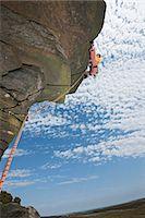 rock climber - Rock climber scaling rock formation Stock Photo - Premium Royalty-Freenull, Code: 649-06401323