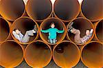 Children playing in industrial pipes Stock Photo - Premium Royalty-Free, Artist: Cultura RM, Code: 649-06401345