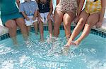 Family dangling feet in swimming pool Stock Photo - Premium Royalty-Free, Artist: Andrew Kolb, Code: 649-06401401