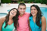 Brother and sisters smiling together Stock Photo - Premium Royalty-Free, Artist: Andrew Kolb, Code: 649-06401405