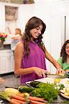 Smiling woman cooking in kitchen Stock Photo - Premium Royalty-Free, Artist: Blend Images, Code: 649-06401407