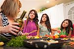 Women cooking together in kitchen Stock Photo - Premium Royalty-Free, Artist: Blend Images, Code: 649-06401411