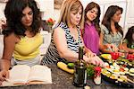 Women cooking together in kitchen Stock Photo - Premium Royalty-Free, Artist: Blend Images, Code: 649-06401414