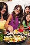 Women cooking together in kitchen Stock Photo - Premium Royalty-Free, Artist: Blend Images, Code: 649-06401416