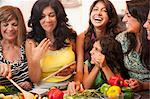 Women cooking together in kitchen Stock Photo - Premium Royalty-Free, Artist: Blend Images, Code: 649-06401417