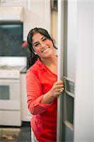 fridge - Smiling woman opening fridge door Stock Photo - Premium Royalty-Freenull, Code: 649-06401420