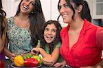 Sisters laughing together in kitchen Stock Photo - Premium Royalty-Free, Artist: Ikon Images, Code: 649-06401423