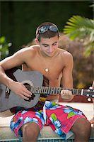 shirtless teen boy - Teenage boy playing guitar by pool Stock Photo - Premium Royalty-Freenull, Code: 649-06401428
