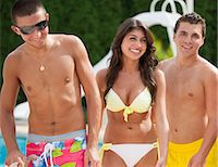 Friends walking by swimming pool Stock Photo - Premium Royalty-Freenull, Code: 649-06401433