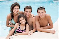 Family relaxing in swimming pool Stock Photo - Premium Royalty-Freenull, Code: 649-06401441
