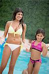 Sisters standing by swimming pool Stock Photo - Premium Royalty-Free, Artist: David & Micha Sheldon, Code: 649-06401447
