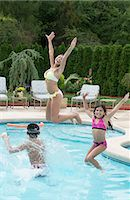 Family playing in swimming pool Stock Photo - Premium Royalty-Freenull, Code: 649-06401450
