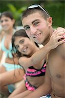 Brother and sister hugging by pool Stock Photo - Premium Royalty-Freenull, Code: 649-06401452