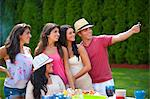 Family taking picture of themselves Stock Photo - Premium Royalty-Free, Artist: Andrew Kolb, Code: 649-06401465