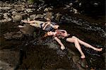 Couple lying down in river Stock Photo - Premium Royalty-Free, Artist: Cultura RM, Code: 614-06402630