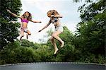 Two girls on trampoline Stock Photo - Premium Royalty-Free, Artist: Masterfile, Code: 614-06402642