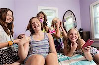 preteen touch - Girls using smartphone in bedroom Stock Photo - Premium Royalty-Freenull, Code: 614-06402651