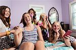 Girls using smartphone in bedroom Stock Photo - Premium Royalty-Free, Artist: Bettina Salomon, Code: 614-06402651