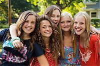 Portrait of friends with arms around each other Stock Photo - Premium Royalty-Freenull, Code: 614-06402666
