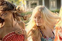 Girls with long hair in sunlight Stock Photo - Premium Royalty-Freenull, Code: 614-06402667