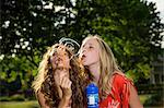 Two girls blowing bubbles with bubble wand Stock Photo - Premium Royalty-Free, Artist: Aflo Relax, Code: 614-06402672