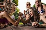 Two girls arm wrestling Stock Photo - Premium Royalty-Freenull, Code: 614-06402691