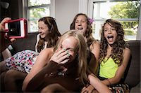 preteen open mouth - Group of girls being photographed with camera phone Stock Photo - Premium Royalty-Freenull, Code: 614-06402696