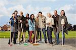 Group of people standing with brooms and mop Stock Photo - Premium Royalty-Free, Artist: Jose Luis Stephens, Code: 614-06402705
