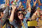 People cheering at a music festival Stock Photo - Premium Royalty-Free, Artist: Blend Images, Code: 614-06402709