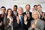Businesspeople clapping Stock Photo - Premium Royalty-Free, Artist: Raymond Forbes, Code: 614-06402718