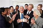 Colleagues giving gift to businessman Stock Photo - Premium Royalty-Free, Artist: ableimages, Code: 614-06402720