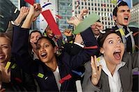 people falling - Businesspeople cheering as ticker tape falls Stock Photo - Premium Royalty-Freenull, Code: 614-06402721