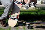 Young couple on bench with skateboards, low section Stock Photo - Premium Royalty-Free, Artist: CulturaRM, Code: 614-06402832