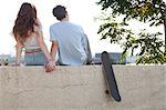 Young couple sitting on wall holding hands Stock Photo - Premium Royalty-Free, Artist: CulturaRM, Code: 614-06402843