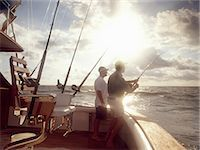 fishing - Men fishing from sport fishing boat Stock Photo - Premium Royalty-Freenull, Code: 614-06402872