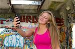 Teenage girl taking a picture of herself on smartphone Stock Photo - Premium Royalty-Free, Artist: Cultura RM, Code: 614-06402876