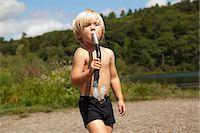 Boy pretending snorkel is instrument Stock Photo - Premium Royalty-Freenull, Code: 614-06402888