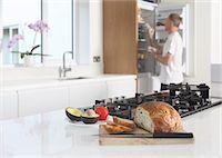 fridge - Man in kitchen, preparing food Stock Photo - Premium Royalty-Freenull, Code: 614-06403000