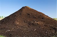 Mound of topsoil in commercial sandpit Stock Photo - Premium Royalty-Freenull, Code: 614-06403007