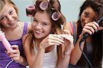 Teenage girls styling their hair Stock Photo - Premium Royalty-Free, Artist: Ikon Images, Code: 614-06403017