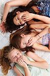 Teenage girls lying on bed and giggling Stock Photo - Premium Royalty-Free, Artist: CulturaRM, Code: 614-06403041