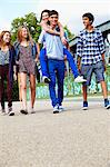 Teenage friends walking Stock Photo - Premium Royalty-Free, Artist: Jim Craigmyle, Code: 614-06403068