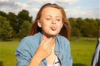 Teenage girl in park, blowing bubble gum Stock Photo - Premium Royalty-Freenull, Code: 614-06403092
