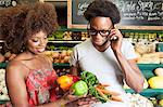Young African American couple buying vegetables at supermarket Stock Photo - Premium Royalty-Free, Artist: Blend Images, Code: 693-06403167