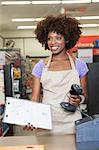 Portrait of an African American female store clerk standing at checkout counter Stock Photo - Premium Royalty-Free, Artist: Aflo Relax, Code: 693-06403172