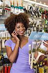 African American woman buying paint Brushes at hardware store Stock Photo - Premium Royalty-Free, Artist: Uwe Umstätter, Code: 693-06403182