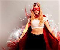 superhero - Portrait of a young woman dressed as superhero Stock Photo - Premium Royalty-Freenull, Code: 693-06403193