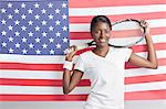 Portrait of young woman with tennis racket against American flag Stock Photo - Premium Royalty-Free, Artist: Cultura RM, Code: 693-06403325