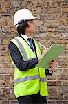 Young male supervisor writing notes at construction site Stock Photo - Premium Royalty-Free, Artist: Michael Alberstat, Code: 693-06403493