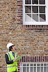 Young male supervisor writing notes at construction site Stock Photo - Premium Royalty-Free, Artist: Cultura RM, Code: 693-06403496